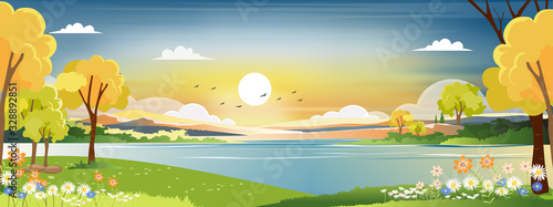 Obraz Panorama landscape of spring village with green meadow on hills with blue and orange sky, Vector Summer or Spring landscape, Panoramic countryside by the lake with sunset in evening. - fototapety do salonu