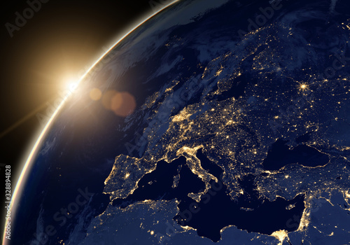 Planet Earth at night, view of city lights showing human activity in Europe and Middle East from space. Elements of this image furnished by NASA. - 328894828