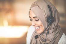 Woman Wearing Headscarf And He...