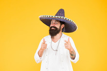 Energetic Mexican Artist. Mexican Traditions. Explore Mexican Culture. Celebrate Traditional Holiday. Happy Man Sombrero Souvenir Straw Hat. Plan Summer Vacation. Tourism Concept. Hipster Having Fun