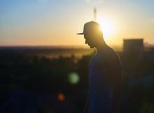 Silhouette Of Man Wearing Cap ...