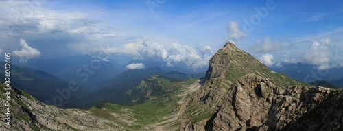 Panorama of mountains, rocky mountains and snow, in the distance you can see mou Canvas Print