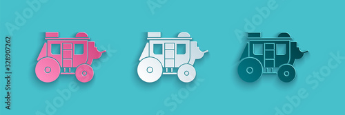 Obraz na plátne Paper cut Western stagecoach icon isolated on blue background
