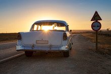 Cuban Baby Blue Classic Car On The Road At Sunset With Sunrays