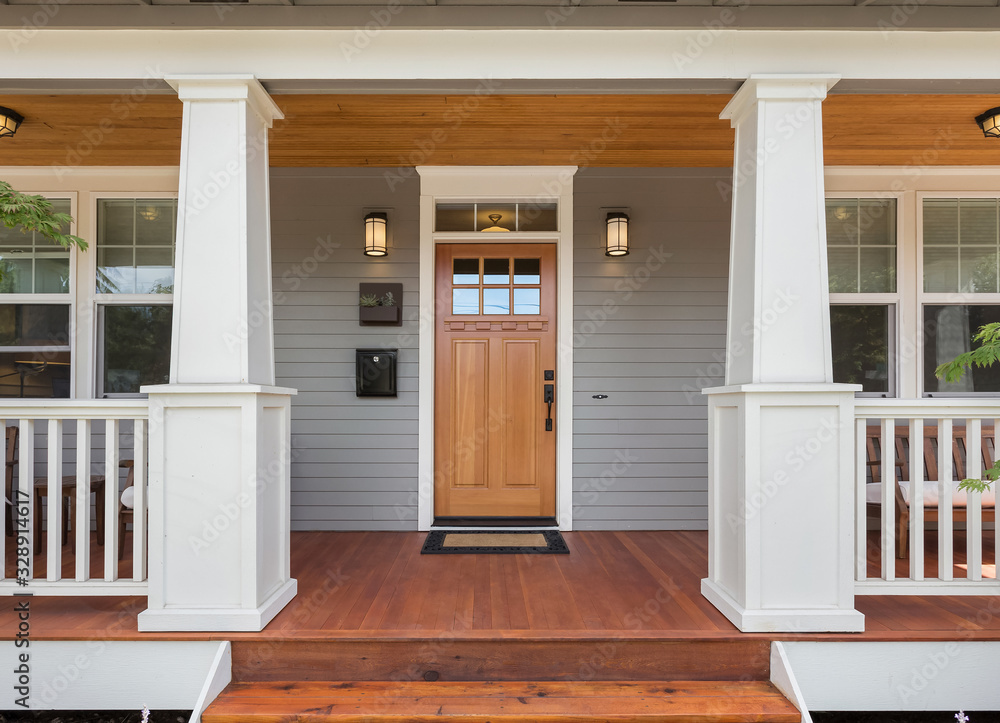 Fototapeta Covered porch and front door of beautiful new home