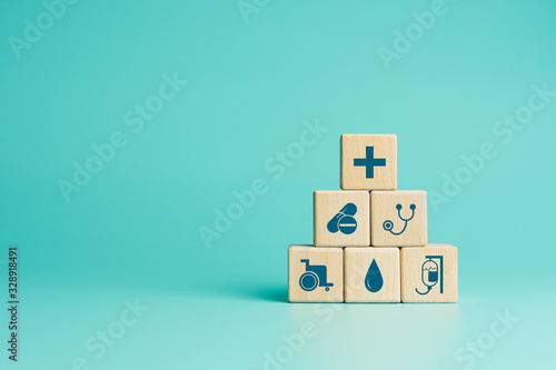 Fotografia Health insurance concept, Wood blocks with healthcare medical icons on blue back