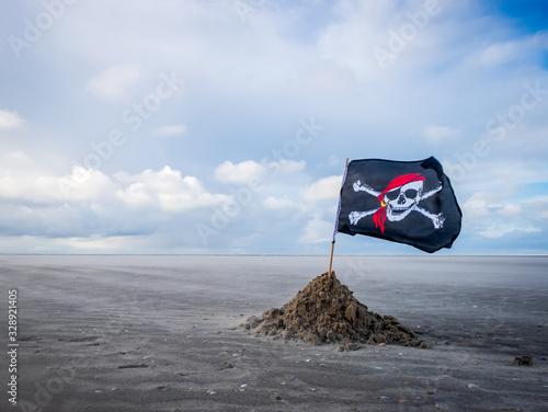 Fotografija pirate flag on a windswept beach
