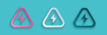 Paper Cut High Voltage Icon Isolated On Blue Background. Danger Symbol. Arrow In Triangle. Warning Icon. Paper Art Style. Vector Illustration