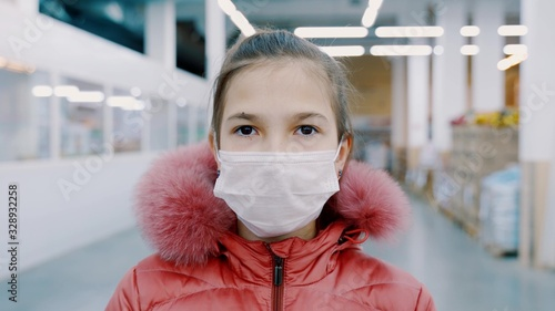 Portrait of a young girl in a medical mask Canvas Print