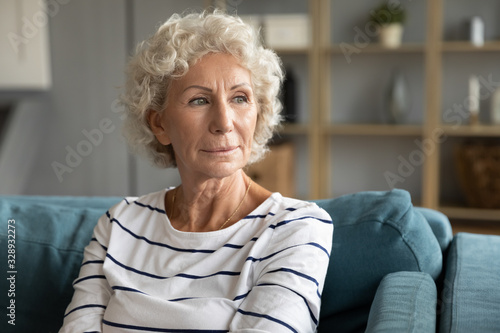 Pensive old middle-aged 60s woman look in distance thinking pondering, thoughtfu Poster Mural XXL