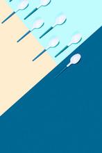 Plastic Spoons On Color Backgr...