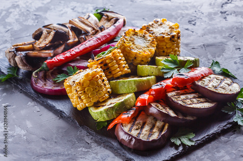 Fototapeta delicious fresh grilled vegetables on a stone plate obraz