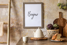 Stylish Composition Of Kitchen Interior With Wooden Mock Up Frame, Family Table, Ladder, Vegetables, Tea Pot, Dessert And Kitchen Accessories. Wabi Sabi Concept Of Home Decor. Country Side. Template.