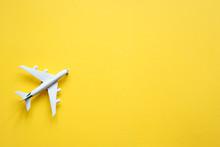 Toy Plane On A Pastel Yellow B...