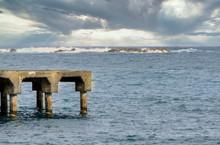 Old Ruins Cement Pier In Ocean
