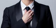 Business Woman Adjusts Her Black Tie
