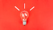 canvas print picture - Top view of light bulb on red background