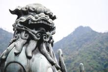 Old And Traditional Lion Stone Statue, Miyajima, Japan