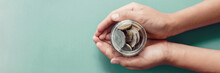 Child Hands Holding Money Jar,  Donation, Saving, Charity, Family Finance Plan Concept, Coronavirus Economic Stimulus Rescue Package, Superannuation, Financial Crisis Concept