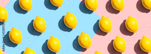 fototapeta na drzwi i meble Fresh yellow lemons overhead view - flat lay