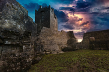 An Ancient Old Castle In Ireland With A Storm And Lightning Landscape