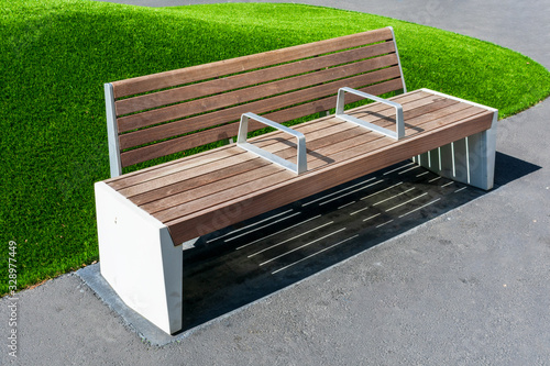 Photo Empty bench with armrest in the middle to prevent people from sleeping, resting