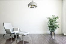 Light White Wall Chair Stylish And Bright Retro Interior With Design Chair And Standing Next To A Small Table With A Book And A Plant On It In A Day Room Interior