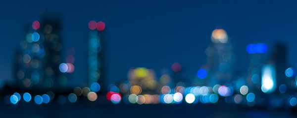 Banner cover of blurred bokeh cityscape at twilight time, city background, ae...