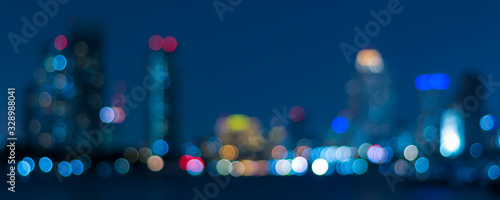 Obraz Banner cover of blurred bokeh cityscape at twilight time, city background, aerial view angle from rooftop ob building, defocused city in downtown,graphic design for web online or book horizontal cover - fototapety do salonu
