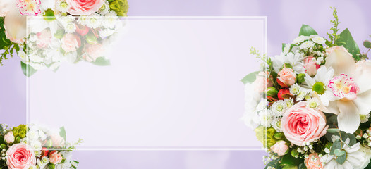 Top view flower bouquet on purple background with gift boxes copy space flat lay