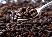 Spoon Of Coffee Beans Over A T...