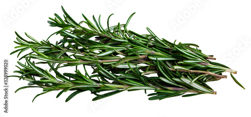 Green sprigs of rosemary on wooden surface