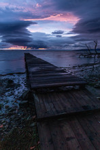 View Of A Pier On A Lake At Du...