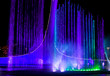 canvas print picture A dancing fountain of blue in the park