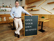 Businessman holds Open your own business sign.
