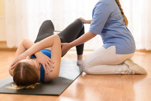 Female Patient Exercising With...