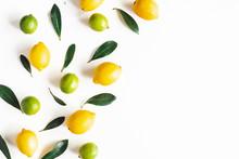 Lemon And Lime Fruits On White...
