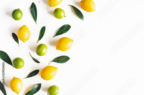 fototapeta na drzwi i meble Lemon and lime fruits on white background. Flat lay, top view