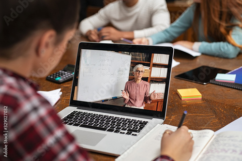 Student watching online lesson