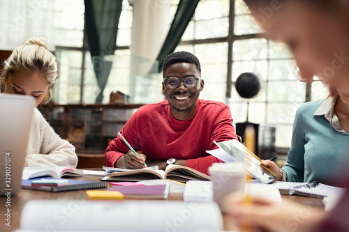 Happy african student smiling