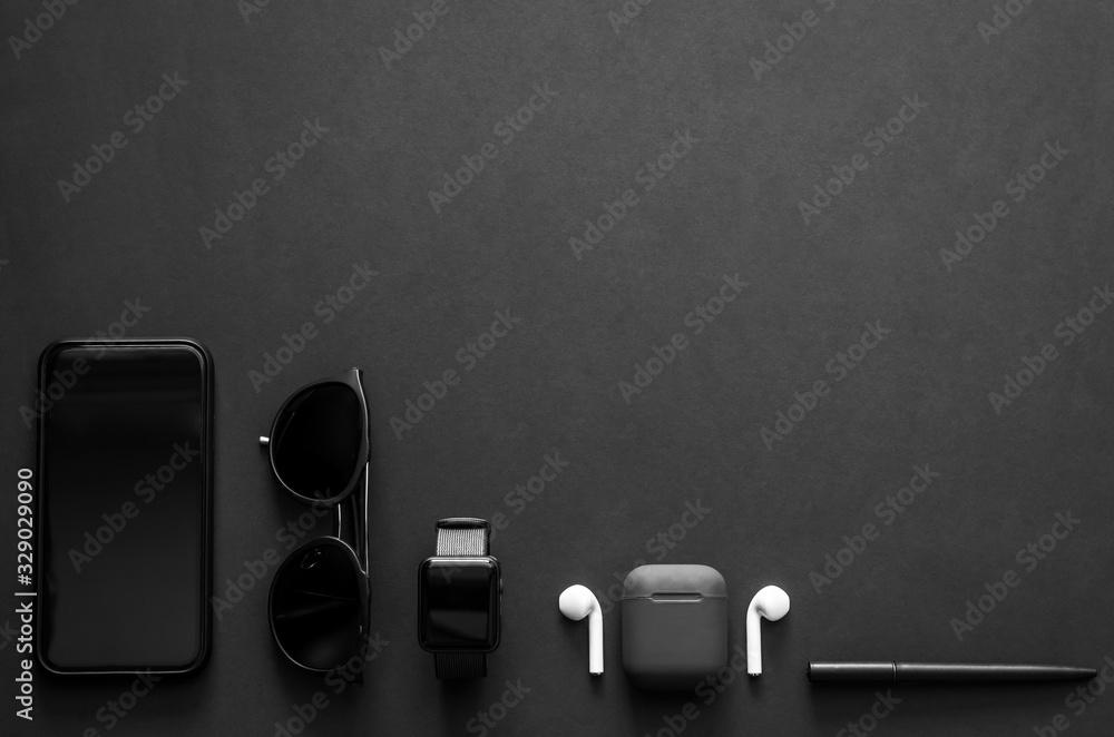 Fototapeta Men gadgets in modern lifestyle on dark background for minimalist flat lay black concept..