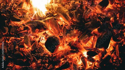 Canvastavla Burning coals close up texture background.