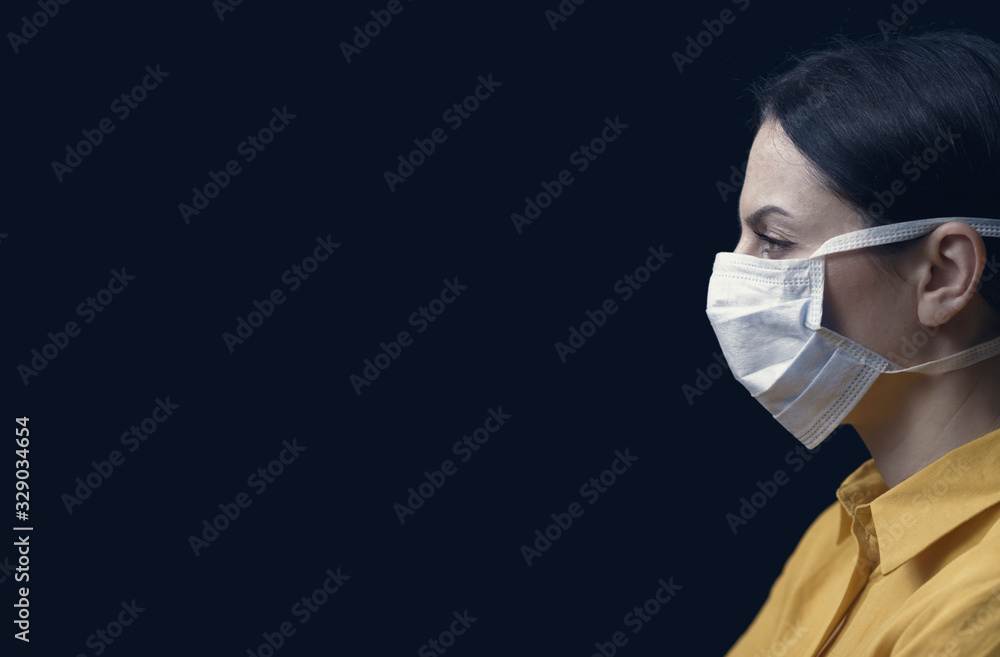 Fototapeta Woman wearing a surgical mask