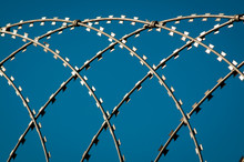 Close Up Of Razor Wire Fence C...