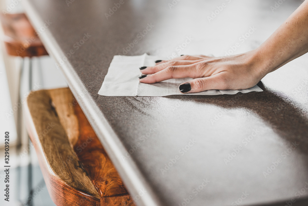 Fototapeta disinfecting surfaces from bacteria or viruses, hand cleaning bar table with disinfectant wet wipe