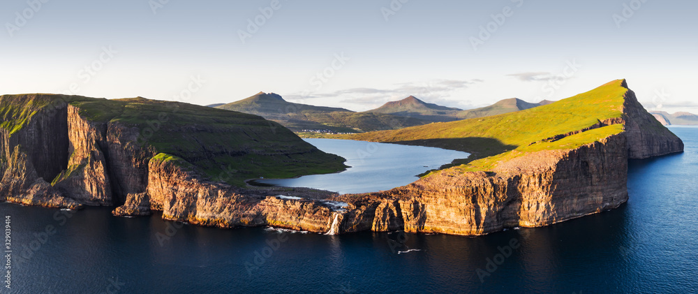 Fototapeta Aerial view from drone of Sorvagsvatn lake on cliffs of Vagar island in sunset time, Faroe Islands, Denmark. Landscape photography