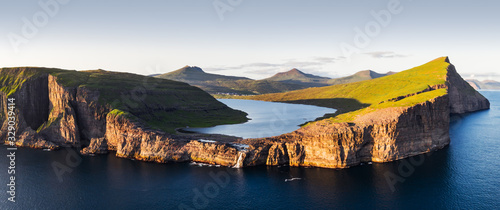 Aerial view from drone of Sorvagsvatn lake on cliffs of Vagar island in sunset time, Faroe Islands, Denmark. Landscape photography - 329039414