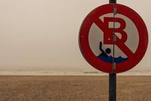 No Swimming Sign At The Beach