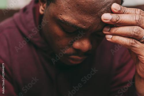 Photo black african american man depicting a sad depressive state, depression concept