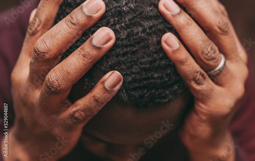 Obraz black african american man depicting a sad depressive state, depression concept - fototapety do salonu